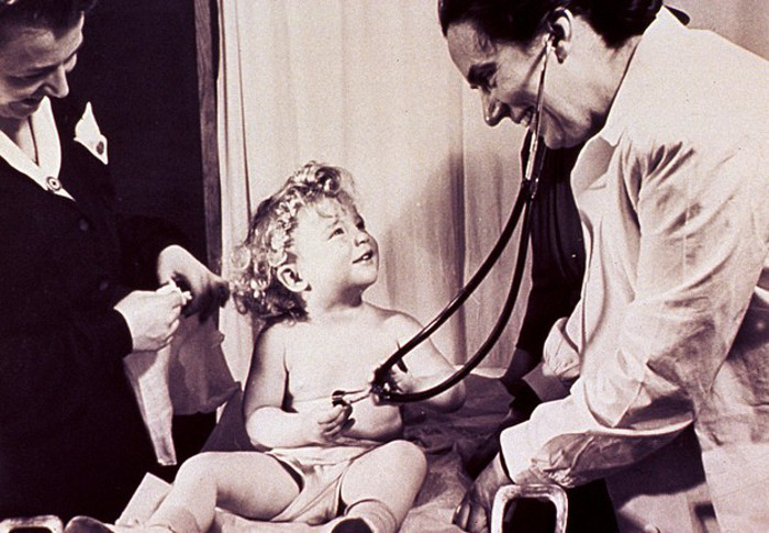 A doctor and a young girl.