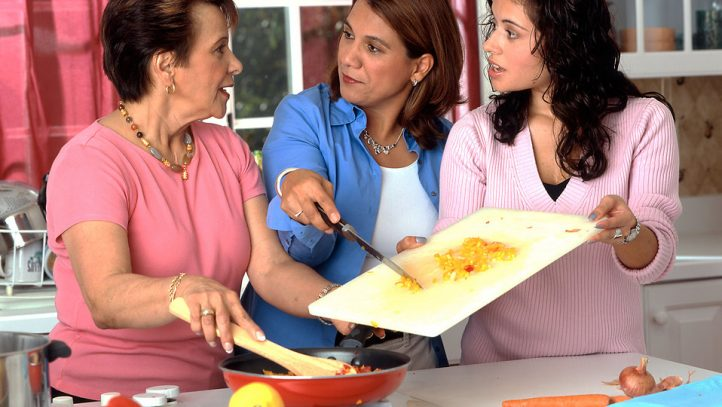 A group of women making some food.