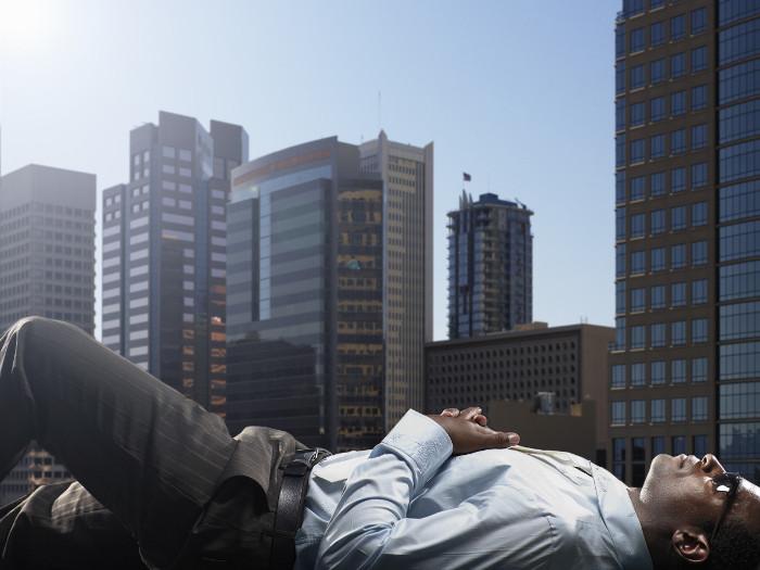 A business man lying down in Phoenix.