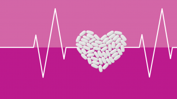 Pills in the shape of a heart represent the side effects of statins