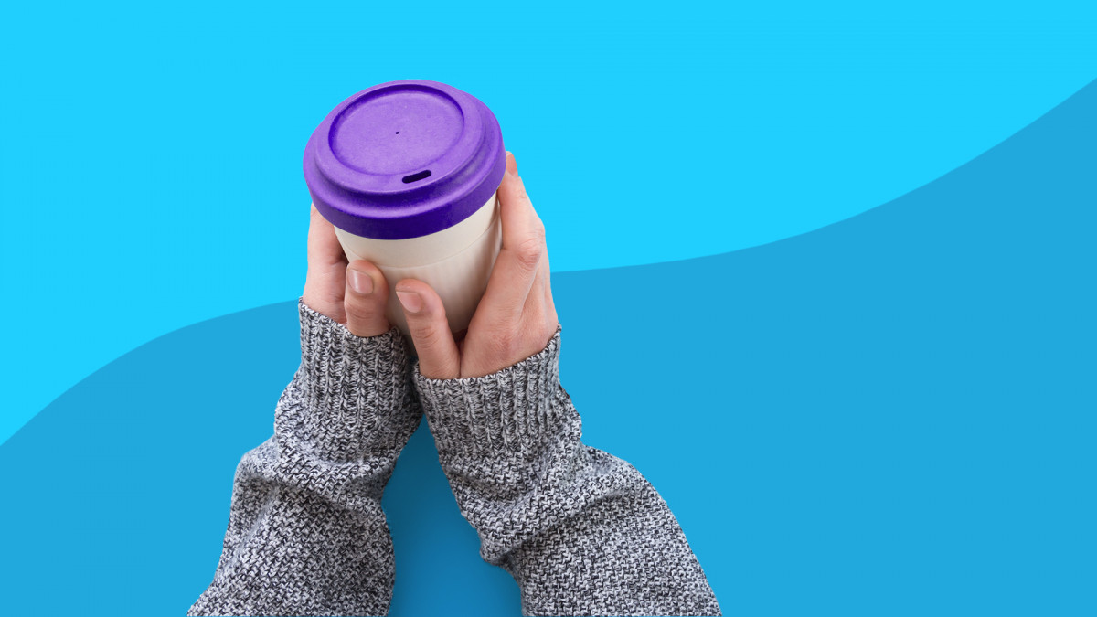 Living with psoriasis - covered hands and coffee cup