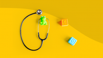 A stethoscope with blocks represents a well child check