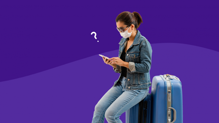 A woman wearing a mask with a suitcase represents coronavirus travel
