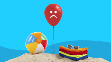 A balloon with a frowning face represents summer depression