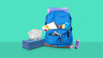 A backpack and inhaler represent an asthma action plan at school